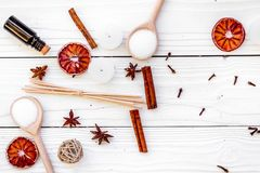 Aromatherapy for relax concept. Spa salt, candles and oil with spices cinnamon, badian and citrus on white wooden. Background top view Stock Images