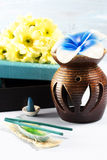 Aromatherapy set with flower candle and incense Royalty Free Stock Images