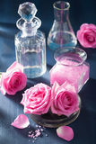 Aromatherapy set with rose flowers salt and flasks Royalty Free Stock Images
