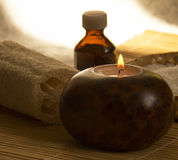 Aromatherapy Spa Concept.Still Life. Aromatherapy Spa Concept Still Life.Aromatherapy Candle and Massage oil in a Zen Style Spa Stock Photos