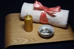 Aromatherapy in spa with pink towel and candle Royalty Free Stock Photo