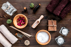 Aromatherapy SPA set with salt and natural oil wooden background top view. Aromatherapy SPA set with salt and natural oil on wooden desk background top view Royalty Free Stock Photos
