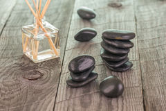 Aromatherapy sticks and black stones Stock Photography