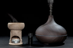 Aromatherapy. Traditional and modern oil burner and aroma diffuser working with essential oil bottle. stock photography