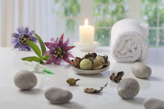 Aromatherapy votive candles burning with a soft glowing flame for wellness treatment in spa Stock Photography