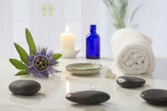 Aromatherapy votive candles burning with a soft glowing flame for wellness treatment in spa Stock Photo