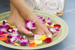 Aromatherapy water spa for feet Royalty Free Stock Images