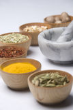 Aromatic. Bowls of spices with mortar and pestle Stock Photos