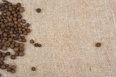Aromatic allspice pepper. Seed on sack cloth stock image