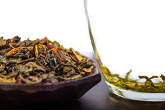Aromatic antioxidant green tea on wooden board Royalty Free Stock Image