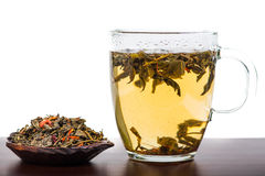Aromatic antioxidant green tea on wooden board Stock Photography