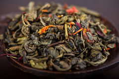 Aromatic antioxidant green tea on wooden board Royalty Free Stock Photography