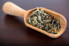 Aromatic antioxidant green tea on wooden board Stock Image