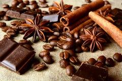 Aromatic assortment of chocolate,coffee,anise and cinnamon on li Stock Photo