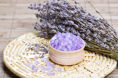 Aromatic bath salt and dry lavender flowers Royalty Free Stock Photo