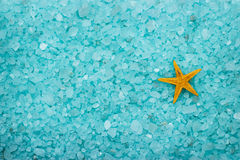 Aromatic bath salt and starfish background Royalty Free Stock Photos