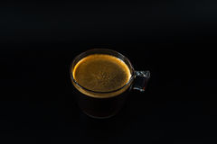 Aromatic black coffee in a glass cup,black background, drink set Stock Image