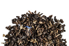 Aromatic black dry tea leaf with petals isolated on a white ba Stock Photo