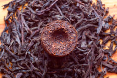 Aromatic black pu-erh tea. From yunnan province in China. Leaves undergoes double fermentation and compressed into bricks. Healthy drink Stock Photography