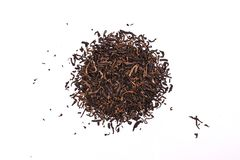 Aromatic black pu-erh tea leaves, a pile of dry red chinese pu-er, close-up, isolated on white. Background stock photos
