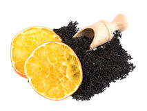 Aromatic black tea, orange and wooden shovel Royalty Free Stock Images