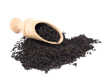 Aromatic black tea and wooden shovel Royalty Free Stock Photo