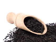 Aromatic black tea and wooden shovel Stock Images