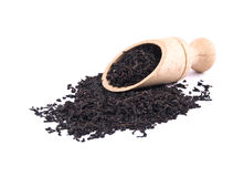 Aromatic black tea and wooden shovel Royalty Free Stock Images