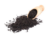 Aromatic black tea and wooden shovel Stock Photos