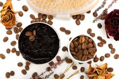 Aromatic botanical cosmetics. Dried herbs flowers mixture, aromatic homemade scrub paste made from coffee grounds and oils. Holistic herbal DIY skincare beauty royalty free stock photography