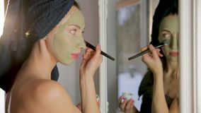 Aromatic botanical cosmetics. Dried herbs flowers mixture, facial mud clay mask, oils, applying brush. Holistic herbal skincare. Beauty hack stock footage