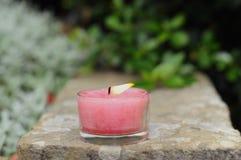 Aromatic candle burning. Outdoors (garden Stock Photo