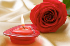 Aromatic candle and red rose Royalty Free Stock Photo