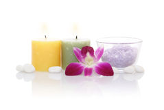 Aromatic Candles, Bath Salt and Orchid. With reflection on white background Stock Image