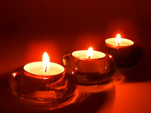 Aromatic candles in glass candlesticks Royalty Free Stock Photos