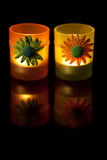 Aromatic candles at night. Candlesticks at dark mirror background. Aromatic candles Royalty Free Stock Photography