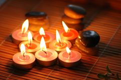 Aromatic candles and pebbles Royalty Free Stock Images