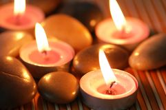 Aromatic candles and pebbles Royalty Free Stock Photos