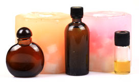 Aromatic candles and perfume bottles Royalty Free Stock Image