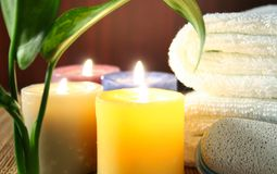 Aromatic candles,Towel and leaf Royalty Free Stock Image