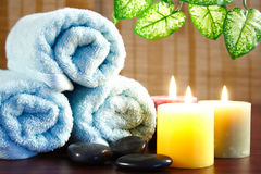 Aromatic candles,towel and leaf Stock Image
