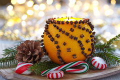 Aromatic Christmas orange with candle Royalty Free Stock Photos
