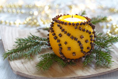Aromatic Christmas orange with candle Royalty Free Stock Images