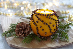 Aromatic Christmas orange with candle Stock Image