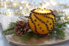 Aromatic Christmas orange with candle stock image
