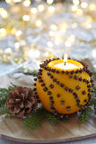 Aromatic Christmas orange with candle Royalty Free Stock Photography