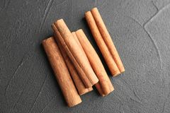 Aromatic cinnamon sticks. On dark grey background Stock Photos
