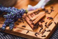 Aromatic cinnamon sticks and lavander close-up Royalty Free Stock Images