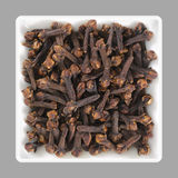 Aromatic cloves in a bowl Stock Images