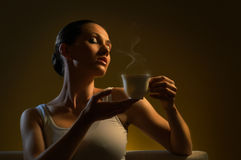 Aromatic coffee. Woman with an aromatic coffee in hands Stock Photos